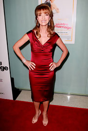 Jane Seymour looks fiery in a red satin cocktail dress for the premiere of 'Love, Wedding, Marriage.'