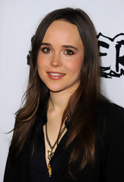 Ellen Page attended the premiere of 'Super' with her hair styled in a straight center part hairstyle.