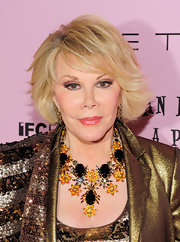 Joan Rivers paired her sequin blazer with a stunning gemstone statement necklace.