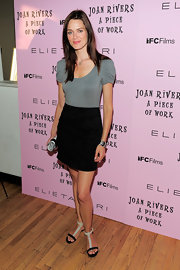 Daniella Van Graas looked casual cool in her black mini skirt and grey cap sleeve top.