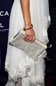 Jessica looked gorgeous in her long delicate dress. She paired her darling look with a white studded clutch.