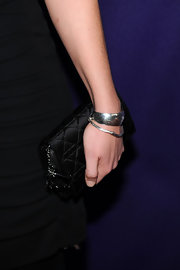 While making an appearance at the Tribeca Film Festival. Kate Hudson looked as glamorous as ever in her black dress, which she paired with a satin quilted clutch.