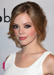 Dreama Walker swept on retro-looking liner and lots of lengthening mascara for the premiere of 'Life Happens.'