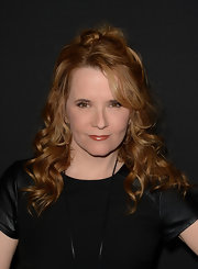 Lea Thompson pinned back her strawberry curls into a stylish and glamorous half up, half down 'do.