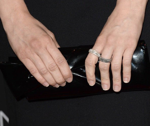 Brittany Snow topped off her chic red carpet look with a classic black leather clutch.