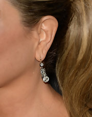 Jennifer Aniston kept her red carpet jewelry to a minimum with a pair of dangle drop diamond earrings.