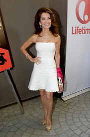 Susan Lucci paired her alluring dress with studded gold peep-toes.