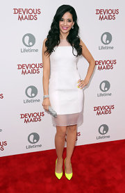 Edy Ganem sported this white sleeveless dress that featured laser-cut center detailing and sheer paneling at the 'Devious Maids' premiere.