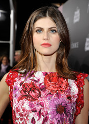 Alexandra Daddario's coral lippy was the perfect finishing touch to her brightly hued outfit.
