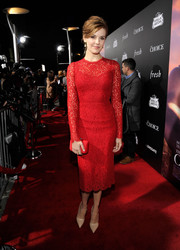Maggie Grace complemented her dress with an elegant red satin clutch.