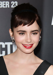 Lily Collins' wore a cool, classic red lipstick to the premiere of 'Abduction'. To try her look, we recommend NARS Lipstick in a shade like Jungle Red.