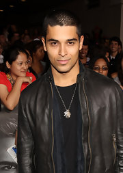 Wilmer Valderrama wore a necklace with multiple pendants at the premiere of 'Abduction.'