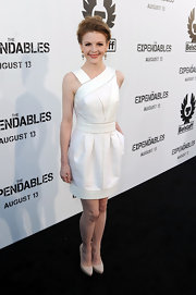 Ashley wore a fabulous paneled cocktail dress with ivory pumps and dangling diamond earrings.