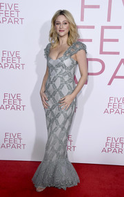 Lili Reinhart looked alluring in a gray lace corset gown by Brock Collection at the premiere of 'Five Feet Apart.'