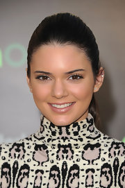 Kendall Jenner wore a shimmering champagne lipstick while attended 'The Hunger Games' premiere.