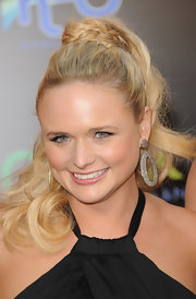 Miranda Lambert attended 'The Hunger Games' wearing her hair in a high ponytail and wrapped with a braid.