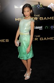 Amandla Stenberg paired her green dress with metallic strappy sandals.