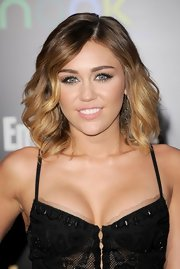 Miley Cyrus wore an ultra-pale pink-beige lipstick at the premiere of 'The Hunger Games.'