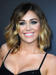 Miley Cyrus wore her hair in soft wavy layers at the premiere of 'The Hunger Games.'