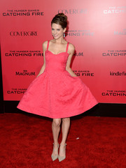 Lyndsy Fonseca exuded 1950s charm in this pink corset dress during the 'Catching Fire' LA premiere.