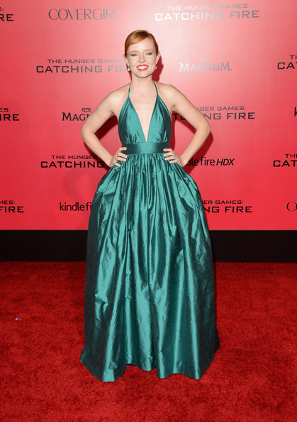 Stef Dawson looked adorable at the 'Catching Fire' LA premiere in a vintage teal halter dress by Shareen featuring a ball-gown skirt.