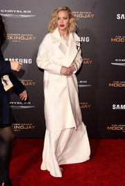 Jennifer Lawrence arrived for the 'Hunger Games: Mockingjay - Part 2' premiere wearing white wool coat over her gown.
