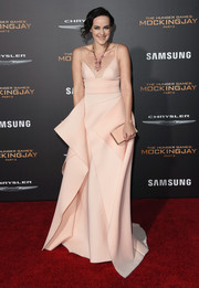Jena Malone looked downright divine at the 'Hunger Games: Mockingjay - Part 2' premiere in a blush-colored Gauri & Nainika gown that looked like a kimono given a modern and sexy twist.