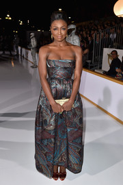 Patina Miller shimmered glamorously in a metallic strapless gown during the 'Hunger Games: Mockingjay Part 1' LA premiere.