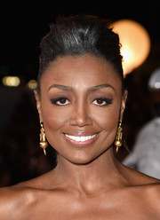 Patina Miller wore an edgy-glam pompadour ponytail to the LA premiere of 'The Hunger Games: Mockingjay Part 1.'