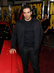 Eli Roth finished off his all-black attire with a zip-up jacket.