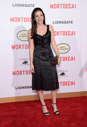 Clara McGregor chose a vintage-style satin LBD for her 'Mortdecai' premiere red carpet look.