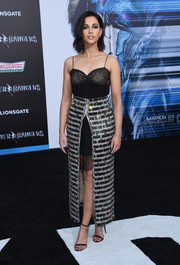 Naomi Scott added a heavy dose of sparkle with a metallic overskirt, also by Chanel.