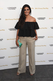 An embellished green satin clutch by Roger Vivier added an elegant pop to Rachel Roy's casual ensemble.