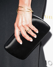 Jennifer Aniston also showed off some elegant gold bangles.
