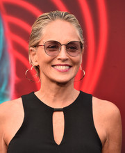 Sharon Stone went for playful styling with a pair of heart-shaped hoop earrings.