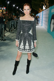 Darby Stanchfield went for a tough-chic finish with a pair of black mid-calf boots by Longchamp.