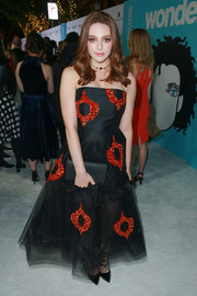 Danielle Rose Russell completed her ensemble with a black leather clutch by Kate Spade.