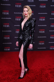 Amber Heard smoldered in a plunging, high-slit sequined gown by Elie Saab at the premiere of 'London Fields.'