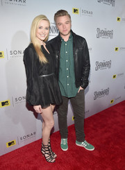 Black gladiator heels rounded out Greer Grammer's sexy ensemble.