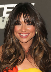 Crystal Reed let her highlighted tresses illuminate on the red carpet with flowing curls.