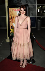 Bryce looked sweet as can be in a peach cocktail dress with gold embroidery at the 'Ceremony' premiere.