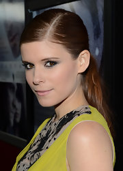 Kate Mara's sharp side part and slicked-back strands gave her classic pony high-fashion edge.