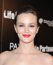 Embracing color, Leighton Meester paired her bold red lipstick with purple eyeshadow.