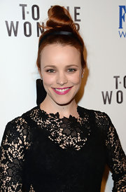 Rachel McAdams styled her newly dyed strawberry hair into this easy-to-accomplish top knot.