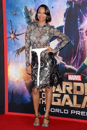 Zoe Saldana paired her top with a Louis Vuitton sequined floral skirt accented with a white T down the front.
