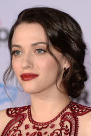Kat Dennings topped off her ultra-elegant look with a swipe of rich red lipstick.