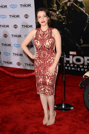 Kat Dennings contrasted her elaborate dress with simple nude pumps by Jimmy Choo.