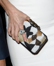 A multicolored beaded Givenchy clutch provided a chicer finish to Julianne Moore's plain white dress at the 'Carrie' premiere.