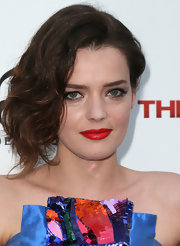 As if her dress wasn't colorful enough, Roxane Mesquida just had to have that extra pop of bright red on her lips.