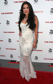 Saye Yabandeh went for a sultry look at the 'Iceman' premiere with this figure-hugging beaded white dress.